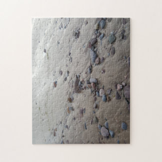 Kiesel auf dem Sand-Foto-Puzzlespiel