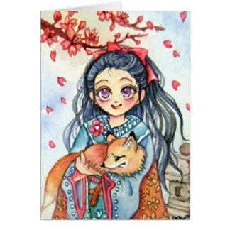 Kimono-Mädchen, das wenig Fox hält Mitteilungskarte