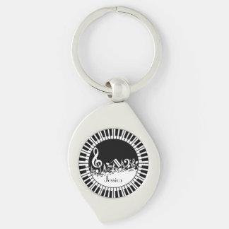 Kreisklavier-Schlüssel und durcheinandergebrachter Silberfarbener Wirbel Schlüsselanhänger