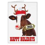 Kuh mit den Ren-Geweihen und Weihnachtsmannmütze Grußkarte