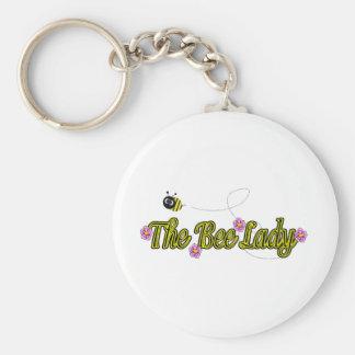la dame d'abeille avec des fleurs porte-clé rond