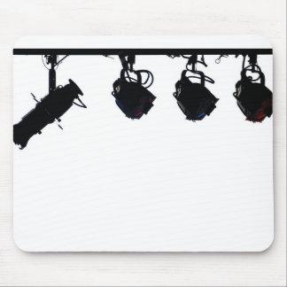 La lumière noire d'étape silhouette l'appareil pho tapis de souris