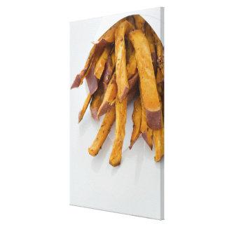 La patate douce fait frire dans le sac de papier,  toiles tendues