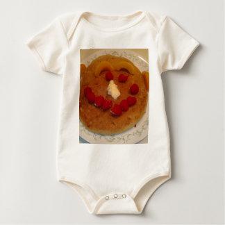 Lächelnder Pfannkuchen Baby Strampler