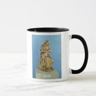 Ländliche Frau, die ihr Kind füttert Tasse