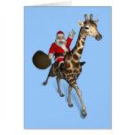 Le père noël montant une girafe cartes