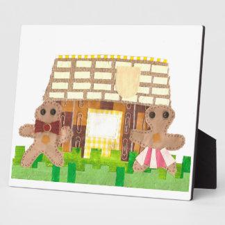 Lebkuchen-Haus-Paare auf einem Gestell Fotoplatte