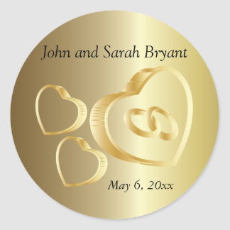 Les coeurs et les anneaux de mariage d'or   sticker rond