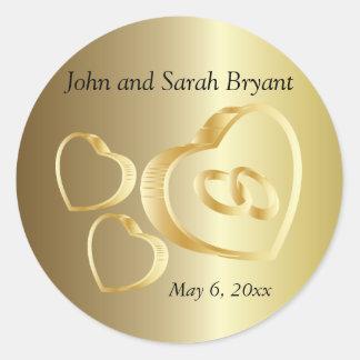 Les coeurs et les anneaux de mariage d'or | sticker rond