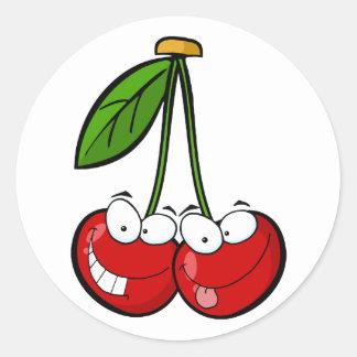 Les personnages de dessin animé de la cerise rouge sticker rond