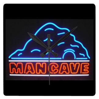 Leuchtreklame-Mann-Höhlen-Wanduhr Quadratische Wanduhr