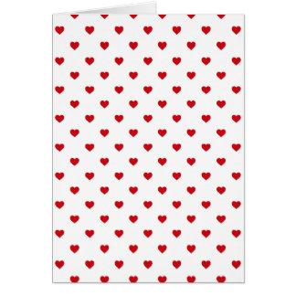 Lippenstift-rote Süßigkeits-Tupfen-Herzen auf Weiß Karte