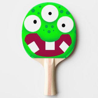lustiges Cartoongrünmonster Tischtennis Schläger