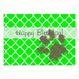 Lustiges Pawprint auf elektrischem grünem Karte