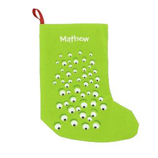 Lustiges verrücktes und neugieriges grünes mit kleiner weihnachtsstrumpf