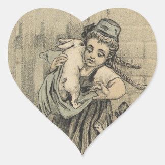 Mädchen, das Kaninchen umarmt Herz-Aufkleber