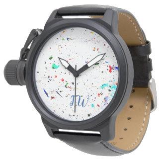 Malen Sie spritzt und beschmutzt abstrakte Kunst Uhr