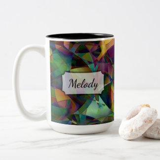 Mehrfarbige, kaleidoskopische abstrakte Kunst mit Zweifarbige Tasse