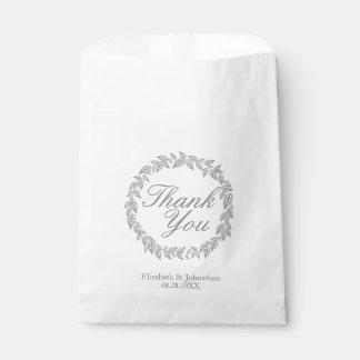 Merci gris de guirlande épousant des sacs de