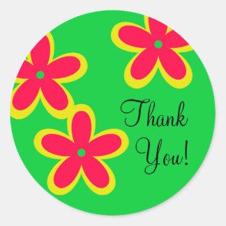 Merci lunatique coloré de fleurs sur le vert sticker rond