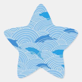 Motif espiègle de dolphines sticker étoile
