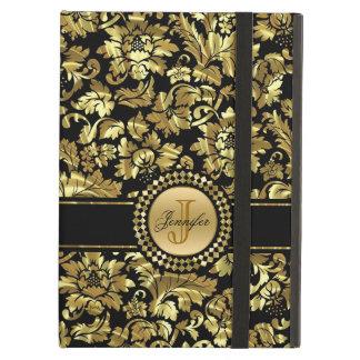 Motif floral d'or et de damassé de noir