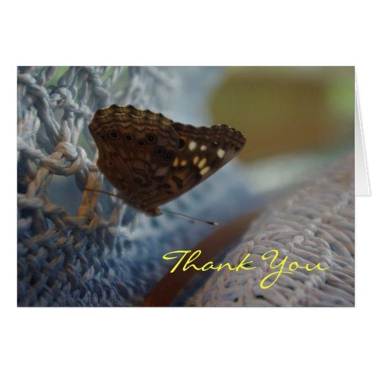Motte auf blauem Hut danken Ihnen zu kardieren Karte