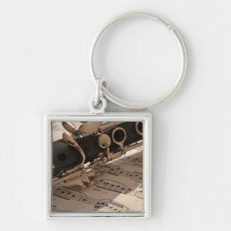 Musikinstrument des Clarinet mit Anmerkung Silberfarbener Quadratischer Schlüsselanhänger