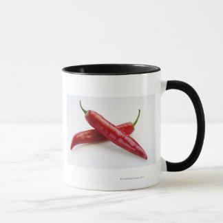 Nah oben von den roten Chili-Paprikaschoten Tasse