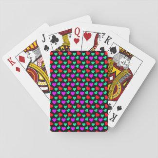 Niedliche lila aquamarine wenig rote Herzen auf Pokerdeck