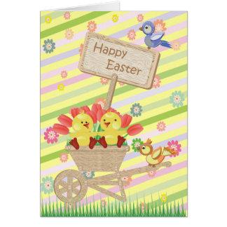 Niedliche Osternküken, -schubkarre, -Blumen u. Grußkarte