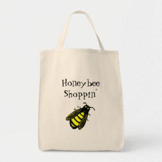 Niedliche schwarze und gelbe Honigbiene mit Tragetasche