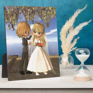Niedliche Toon-Hochzeits-Paare auf einem Fotoplatte