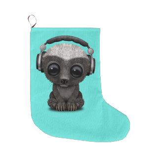 Niedliche tragende Kopfhörer Baby-Honig-Dachs-DJ Großer Weihnachtsstrumpf