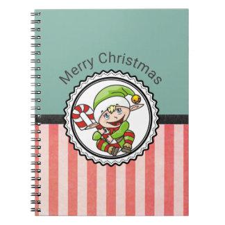 Niedlicher Feiertags-Elf mit Zuckerstange-frohen Notizblock