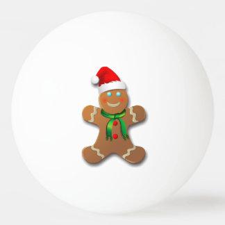 Niedlicher Lebkuchen-Mann mit einer roten Tischtennis Ball