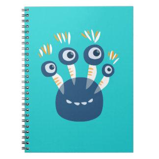 Niedliches blaues Cartoon-Monster mit vier Augen Notizblock