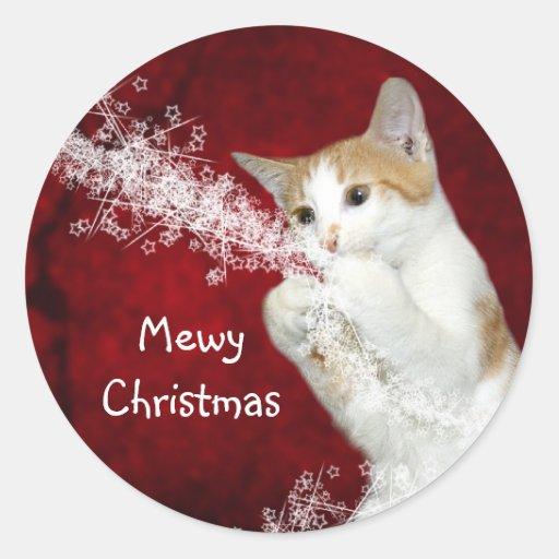 Noël espiègle de minou adhésif
