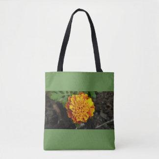 Orange Blumengrünhintergrund tragen Tasche