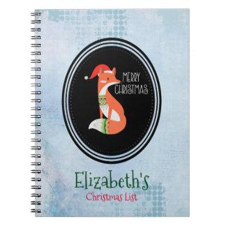 Orange Fox in den rote Weihnachtsmannmütze-frohen Notizblock