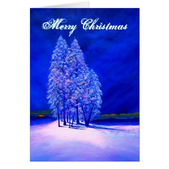 Orange Mond, der an den eisigen Weihnachtsbäumen Grußkarte