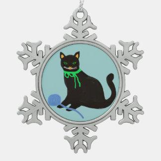 Ornement espiègle de flocon de neige de chat noir