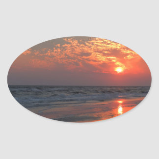 Ozean-Sonnenuntergang - Eichen-Insel, NC Ovaler Aufkleber