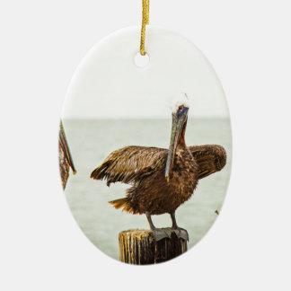 Pelikane gehockt auf Posten Keramik Ornament