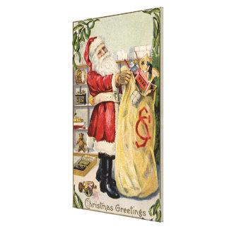 Père Noël tenant un sac de débordement des jouets Impression Sur Toile