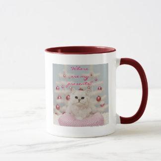 Persische Katze, die auf rosa Kissen sitzt Tasse