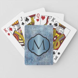 Photorealistic Grungy blaues Metall mit Monogramm Spielkarten