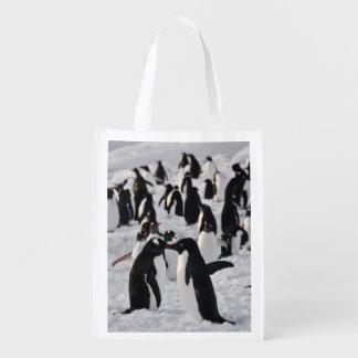 Pingouins au jeu sac réutilisable d'épcierie
