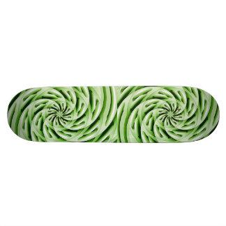 Planche à roulettes verte abstraite d'oeufs planches à roulettes