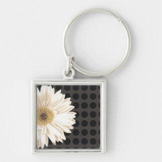 Points de noir de fleur blanche porte-clefs